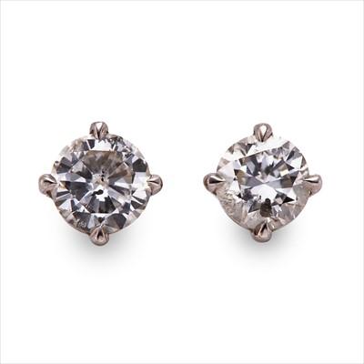 Lot 11-A pair of diamond ear studs.