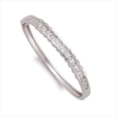 Lot 19-A diamond hinged bangle.