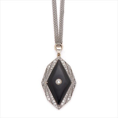 Lot 6-An early 20th century onyx and diamond pendant.