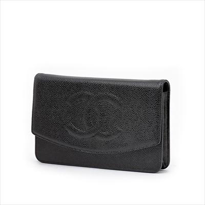 Lot 8-Chanel - a black caviar leather Timeless WOC handbag.