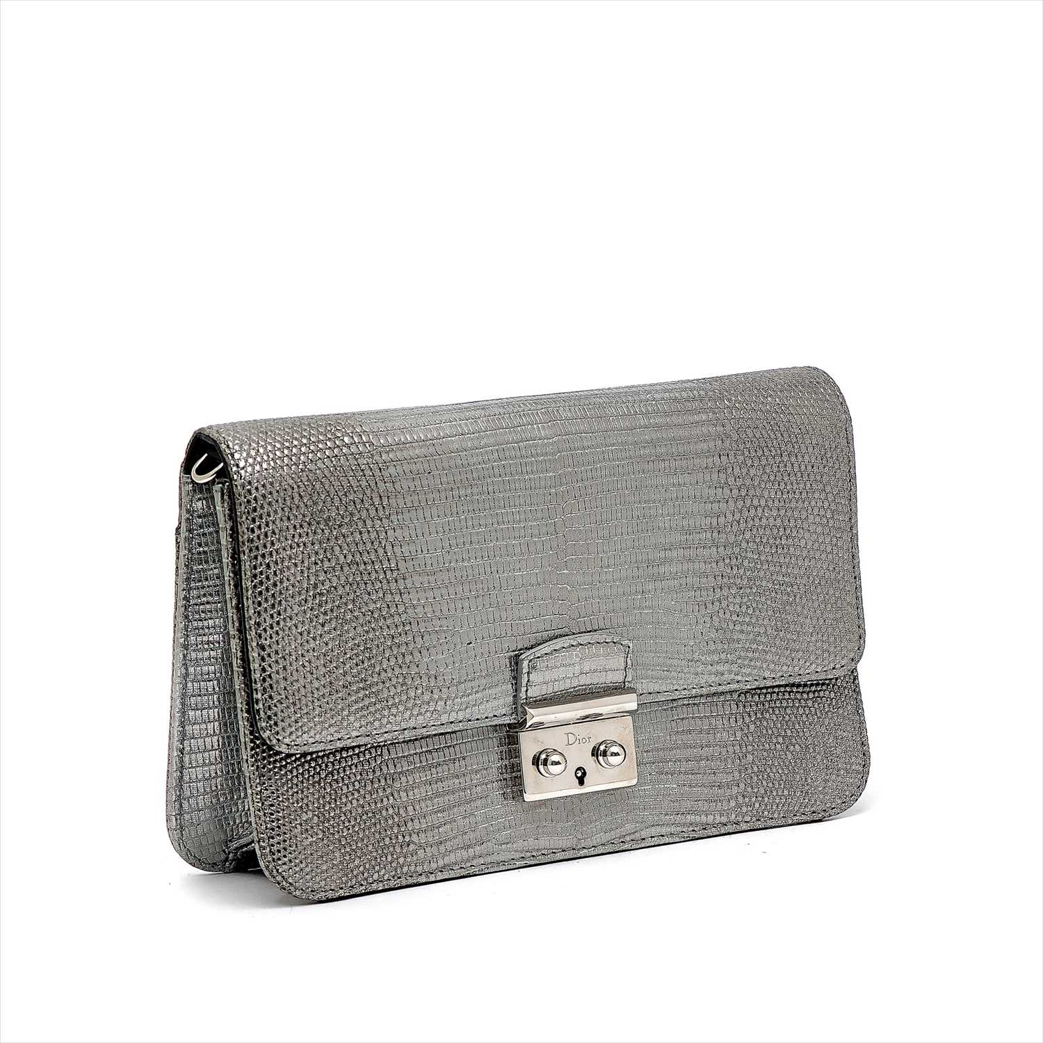 Lot 3-Christian Dior - a silver embossed leather handbag.