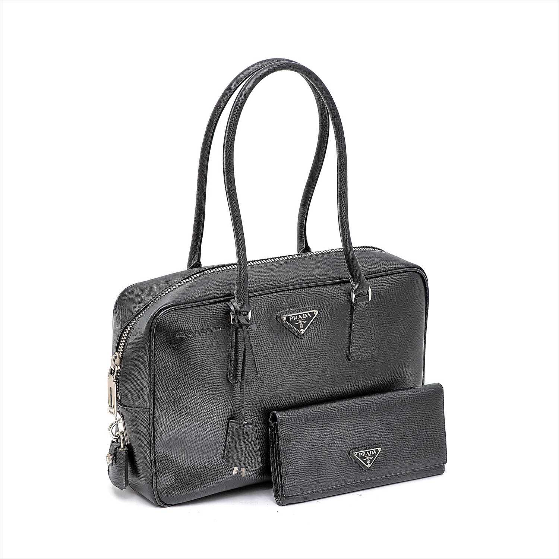 Lot 59-Prada - a black Saffiano leather handbag and purse.