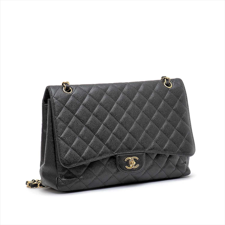 Lot 226-Chanel - a caviar Maxi Classic Single Flap handbag.