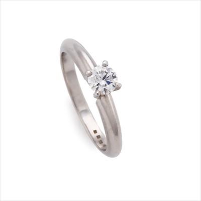 Lot 18-A diamond single-stone ring.