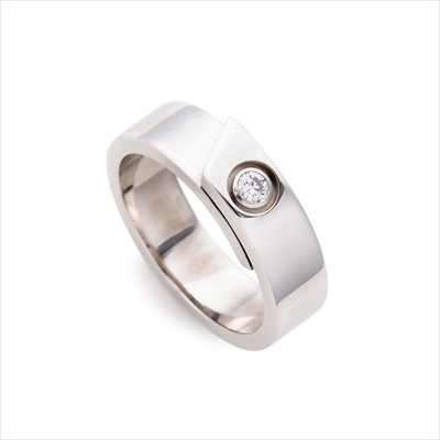 Lot 17-Cartier - an 18ct gold diamond Signature Anniversary ring.
