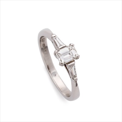 Lot 1-A platinum diamond three-stone ring.
