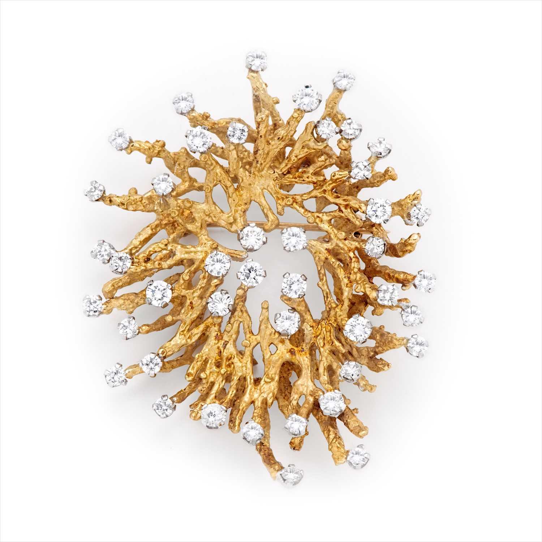 Lot 131 - A 1970s diamond abstract pendant.