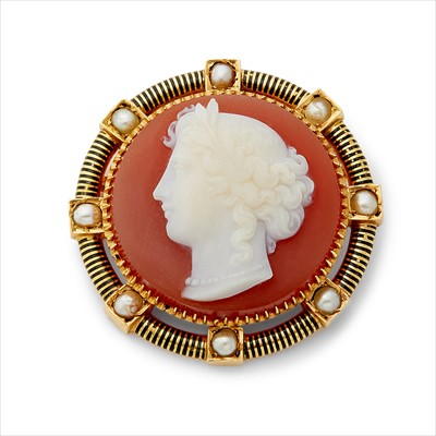 Lot 25-A late Victorian hard stone cameo and split pearl brooch.