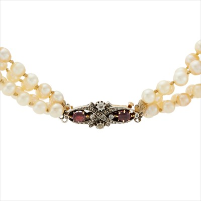 Lot 8-A cultured pearl four-row necklace, with a Victorian ruby and diamond clasp.
