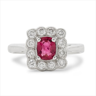 Lot 1-An 18ct white gold ruby and diamond cluster ring.