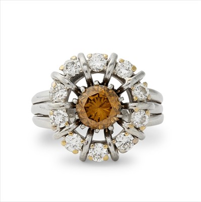 Lot 26-A fancy yellow-brown diamond and diamond cluster ring.