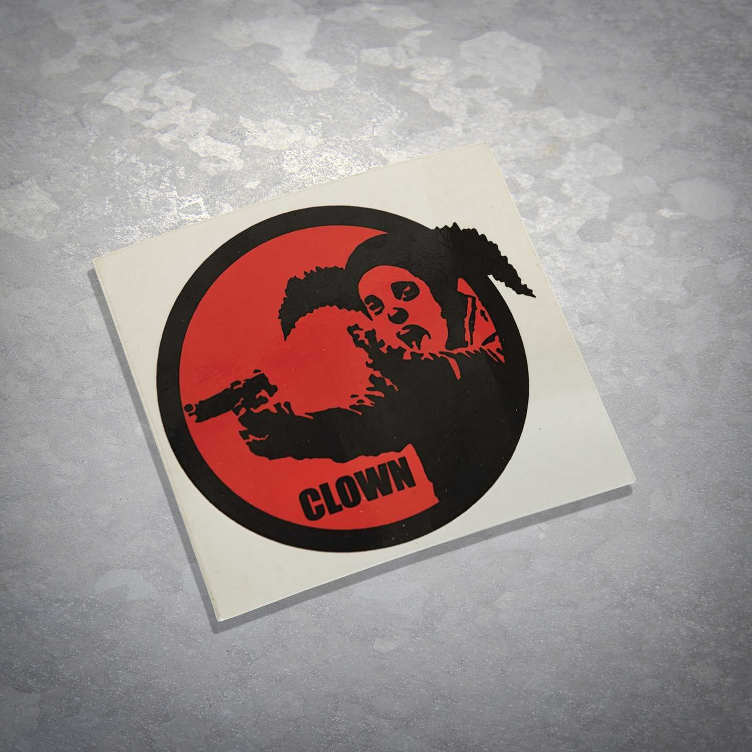 Lot 51 - Banksy (British 1974-), 'Clown Skateboards Sticker (Red & White)', 2001 (Two Works)